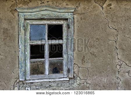 Window in an old ruinous house .