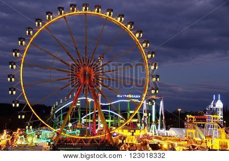 Frankfurt, Germany - March 23:  Ferris wheel and rides in Frankfurter Dippemess in 2016