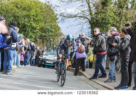 Conflans-Sainte-Honorine, France-March 62016: The Welsh cyclist Geraint Thomas of Team Sky riding during the prologue stage of Paris-Nice 2016. Thomas won Paris Nice 2016.