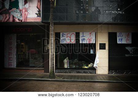 ZHONGSHAN GUANGDONG CHINA-Mar 17, 2016:store hangs with '50 for everything'&'clearance sale'&'shutdown'in Zhongshan,Guangdong,China.