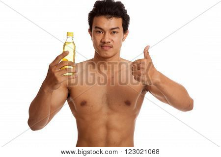 Muscular Asian man thumbs up with electrolyte drink  isolated on white background