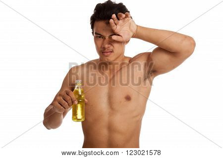Exhausted Muscular Asian Man With Electrolyte Drink