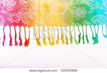 Colors of the rainbow bands on Indian fabric as a background. Rainbow gradient with a traditional pattern on stoles. The colors of the rainbow LGBT community. Symbol gay. Brushes on the scarf. Isolation on a white background.