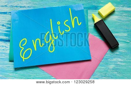 English words learning education concept lettering posters writing notebook note grey wooden background Word refer news current affairs special occasions business planning