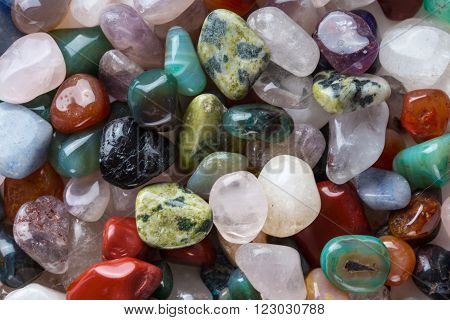 Agate stone with many colorful minerals. Natural background