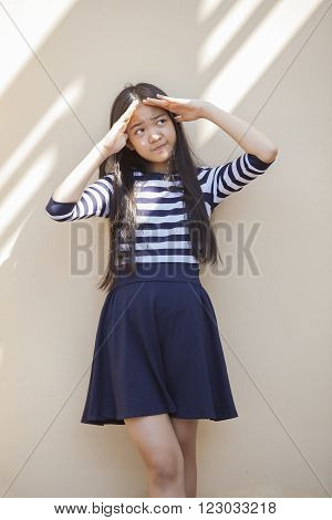 portrait of asian teen age smiling face standing at home with relax and happy emotion