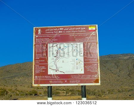 JEBEL SHAMS, OMAN - DEC 14, 2004: sign with trekking route  with special points of interests to guide the tourists at Jebel Shams, Oman.