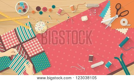 Seamstress working with quilting fabric sewing equipment and fabric on a wooden worktop sewing hobby and creativity concept