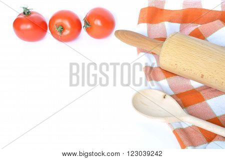 Checkered dishcloth spoon tomatoes and rolling pin isolated on white