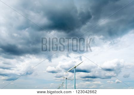 impressive skies with clouds and wind turbines