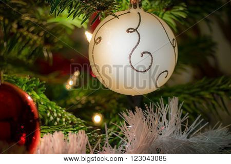 Christmas balls and lights situated in a christmas tree