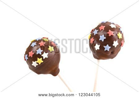 Two cakepops with stars decoration on isolated background