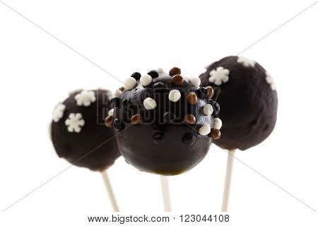 Three tasty chocolate cakepops on isolated background