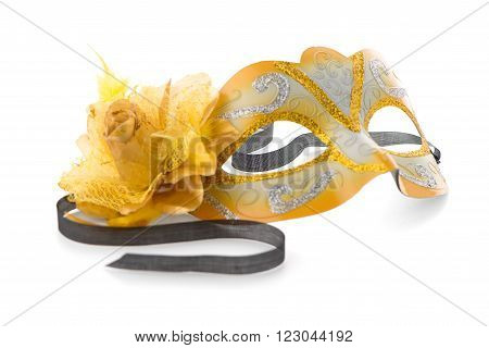 Yellow venetian mask for a party on a white background