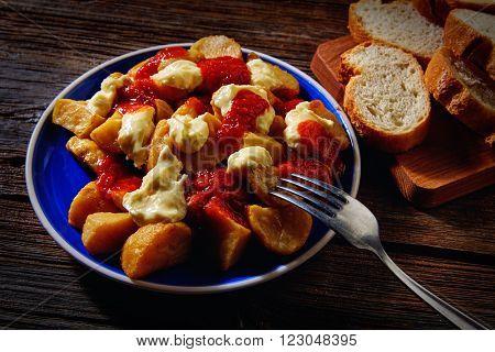 Tapas Patatas Bravas potatoe fries with tomato and mayonaise from Spain potatoes