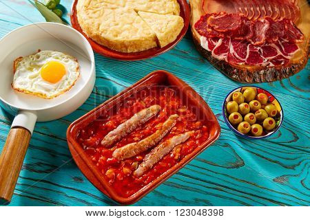 Tapas pisto con tomate ratatouille egg and sausage from Spain