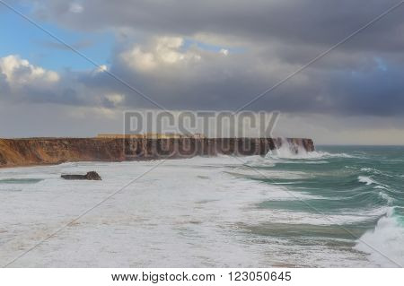 Sagres fortress in stormy day and giant waves. Portugal