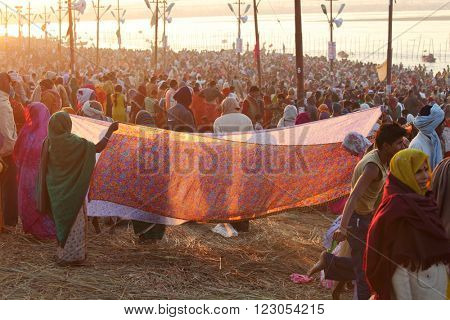 ALLAHABAD, UTTAR PRADESH, INDIA - FEBRUARY 08, 2013: Women put their sari out to dry on wind after ritual holy bathing in the Ganges river during the festival Kumbh Mela