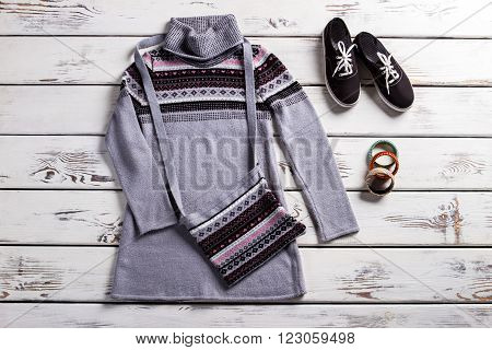 Tunic with keds and purse. Lady's spring outfit on shelf. Simple outfit for cool weather. Clothing and footwear for women. poster