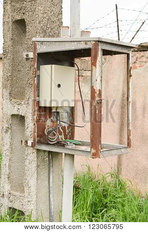 Electrical box placed in an old metal frame on a pole