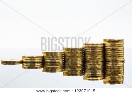 stacked coins uptrend
