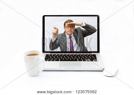 A businessman trapped inside the screen of a laptop and looking for help by knocking on the screen. The laptop is on a desk with an isolated white background.