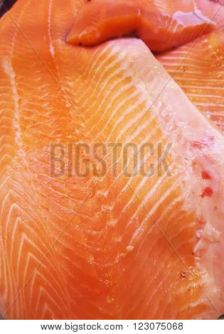 Delicious salmon fillet, rich in omega 3 oil.  Healthy food, diet and cooking concept.