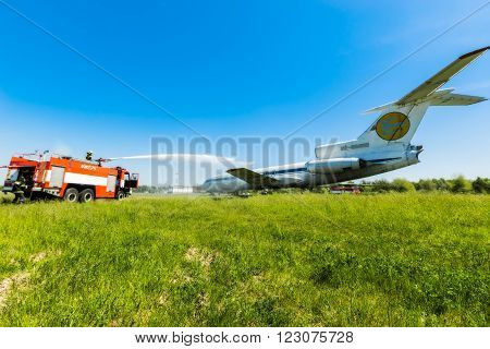 Ukraine, Borispol - MAY 22 : Fire Service International Airport Boryspil spends doctrines on suppression aircraft on May 22, 2015 in Borispol, Ukraine