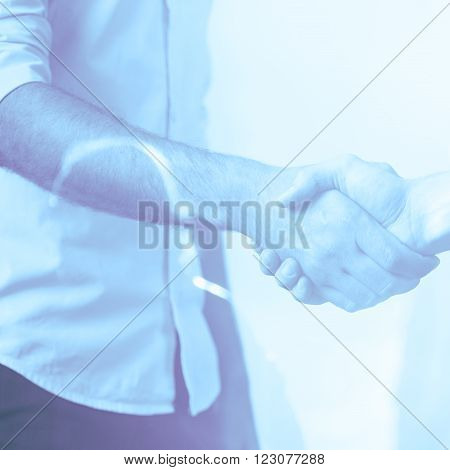 Double exposure of friendly handshake blue impression