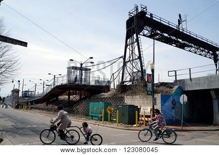 JOLIET, ILLINOIS / UNITED STATES - APRIL 12, 2015:  People awaiting a passenger train may ascend the ramp to the platform.