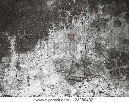 Old cracked plaster on the wall. Grunge concrete texture. Grunge stucco background. Retro texture. Vintage texture. Distress Texture. Scratched wall pattern