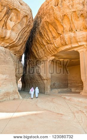 Madden Saleh, Saudi Arabia - November 24 2008: Local people in the archaeological site with the Nabatean tomb of the 1st century.