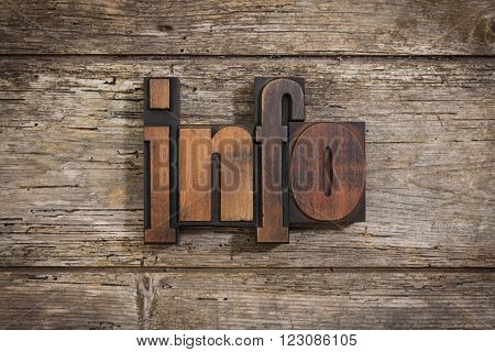 info, single word set with vintage letterpress printing blocks on rustic wooden background