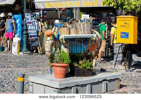 THIRA, SANTORINI, GREECE - AUGUST 26, 2016: Sculpture of donkey as decoration of main street of Thira town.