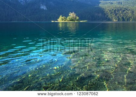 Fantastic day on mountain lake Eibsee, located in the Bavaria, Germany. Dramatic unusual scene. Alps, Europe.