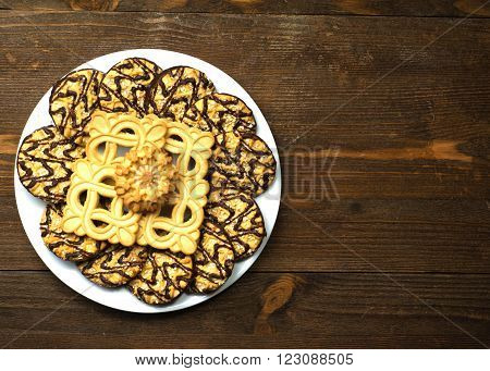 Cookies On A Plate On A Wooden Background.