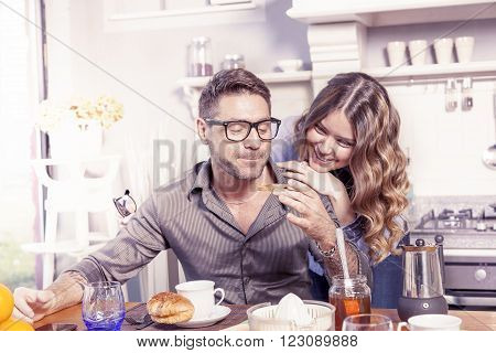Pretty Young Couple Have Fun In The Kitchen While Preparing Breakfast