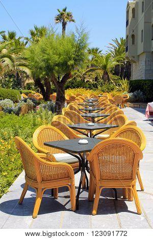 CRETE, GREECE - JULY 23, 2015: Al fresco wicker seats on the mediterranean hotel terrace, Crete, Greece