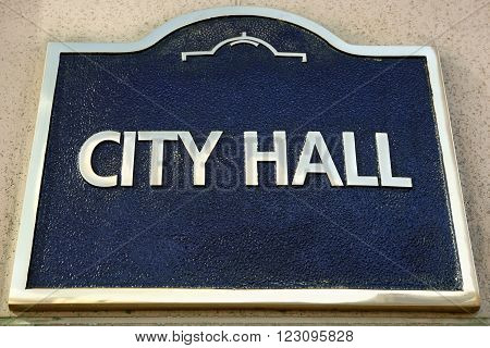 City Hall sign on the outside wall of a local government building close up