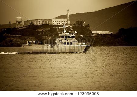 SAN FRANCISCO, CALIFORNIA - DECEMBER 21: A military vessel of the U.S. Army Corps crosses Alcatraz Island in San Francisco Bay on 21 December 21 2015 in San Fransisco.