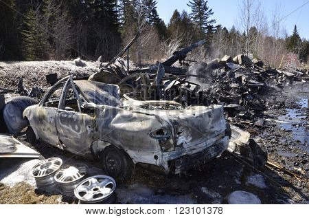 Recently burnt garage and car. Destroyed by flames in early morning.