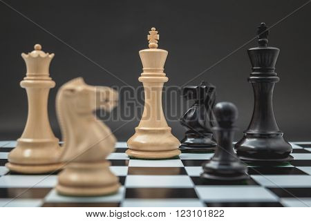 Black And White King And Knight Of Chess Setup On Chessboard And Dark Background . Leader And Teamwo