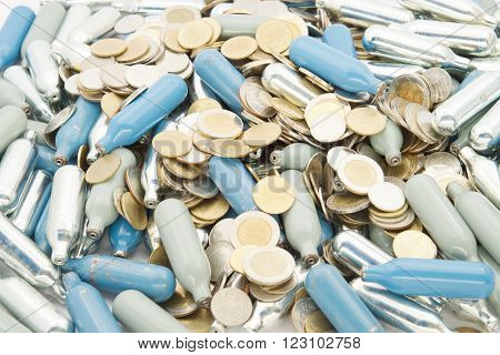 Stack Of Silver And Blue Gas Container With Gold Coins