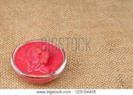 Macro Delicious Beet Horseradish on sackcloth background