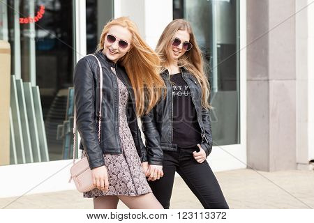 Two Girl Posing With Sunglasess Posing Outside