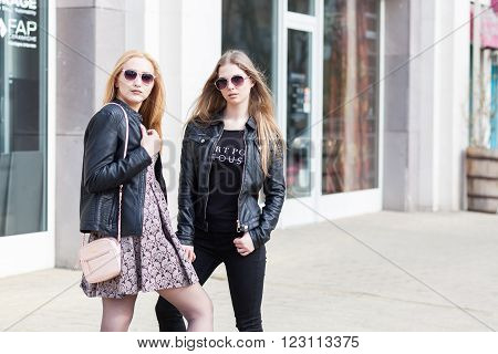 Girl In Leather Jackets And Sunglasess Posing Outside