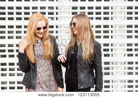 Best Friends In Sunglasess Laughing On Cell Type Industrial Background