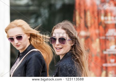 Girls Taking A Walk And Smiling At Camera