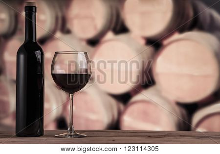 Wine barrels in the wine cellar. Wine background