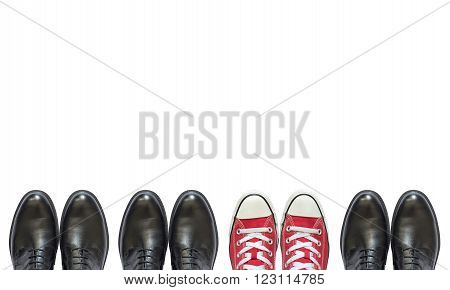 red sneakers and man business shoes isolated